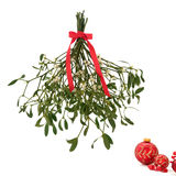 Mistletoe. With berries and tied with a red bow with christmas baubles to one side, isolated over white background stock images