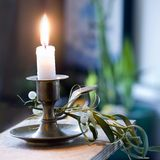 Mistletoe and candle light Stock Photography