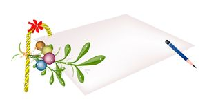 Mistletoe and Candy Cane on Blank Page Royalty Free Stock Photography
