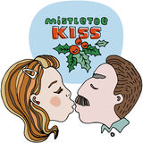 Mistletoe kiss editable vector illustration with red and green title. Green leafs and red berries. Cartoon vector template design Stock Photos