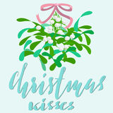 Mistletoe with pink bow and curly ribbon. Christmas lettering. Vector illustraton. Stock Photos