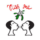Mistletoe women kiss Stock Photo