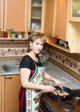 The mistress prepares cutlets royalty free stock image