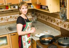 The mistress prepares cutlets stock photography