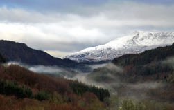 Mists covering the forests of the Penmachno Valley Stock Photo
