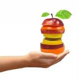 Mistura da fruta nas mãos imagens de stock