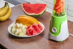 Misturador com melancia, melão e bananas Imagem de Stock Royalty Free