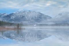 Misty atmospheric morning on Barmsee lake Royalty Free Stock Photo