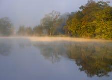 Misty autumn dawn stock images