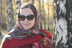 Woman in the national patterned scarf Stock Photo