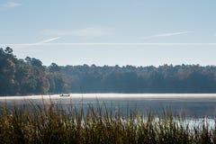 Misty Autumn Morning Fishing Trip stock foto's