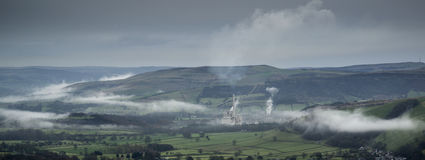 Misty Autumn morning landscape of Derwent Valley from Mam Tor in Royalty Free Stock Photos