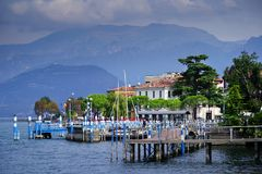 Misty autumn morning light over Porto Gabriele Rosa on Iseo town. Iseo harbour. Lago d`Iseo or Sebino is the fourth largest lake in Lombardy, Italy, fed by the stock image