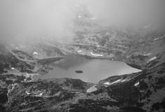 Misty black and white lake. High mountain lake in black and white Stock Photo