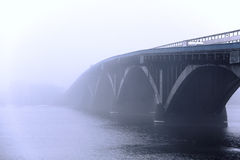 Misty bridge. Over the river Royalty Free Stock Images