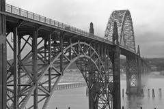 Misty bridge dark HDR ocean side black and white Royalty Free Stock Image
