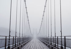 Misty bridge Stock Images