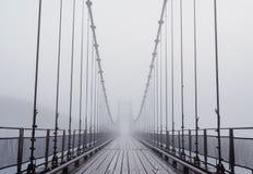 Misty bridge Stock Images