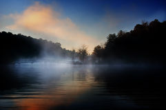 Misty bridge sunrise. A misty foot path bridge crosses a lake during sunrise in the Georgia mountains. Concept for a destination vacation royalty free stock photos