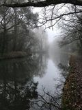 Misty canal morning royalty free stock photography