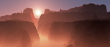 Misty canyon landscape with river at sunrise. Stock Image