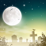 Misty Cemetery. A Misty Graveyard, Cemetery with Tombstones and Moon Stock Images