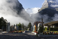 Misty Cemetery. Misty Cemetery located in Grindelwald Switzerland, with the Alps in the background Royalty Free Stock Images