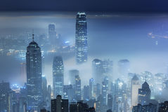 Misty City. Misty night view of Victoria harbor in Hong Kong city stock photography