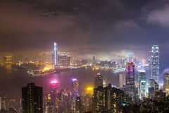 Misty city and Skyscraper in fog at night Royalty Free Stock Image