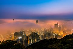 Misty City view from peak at dawn Stock Photo