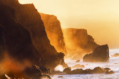 Misty cliffs in the basque country coast Stock Images