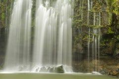 Misty Cliffs of Llanos de Cortés waterfall Stock Images