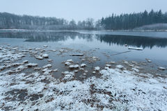 Misty clouded winter morning on lake Stock Photo