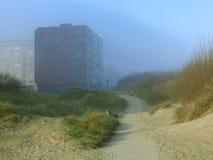 Misty coastal apartments Stock Images