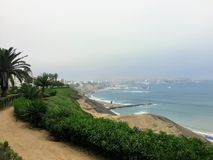 The misty coastline of Lima, Peru on a gray May day along the pa stock photography