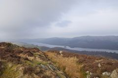 Misty Coniston Water: lake in English Lake District from mountain moor stock photography