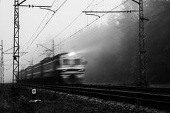 Misty country railroad in the early morning Royalty Free Stock Image