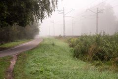 Misty country railroad in the early morning Stock Photo
