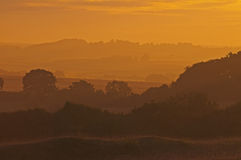 Misty dawn breaks over vale of blackmoor. Dawn over the dorset countryside as summer turns to autumn royalty free stock images