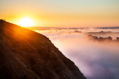 Misty dawn from hill over Valley and the forest Stock Photo