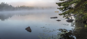 Misty Dawn on a Lake in Ontario, Canada Royalty Free Stock Photos