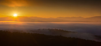 Misty dawn over  mountains Stock Image