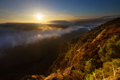 Misty dawn over  mountains Stock Images