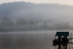 A misty dawn over a river in a tropical rainforest. Just before sunrise on the Sungai Kinabatangan river in the rainforest of Borneo Stock Photography