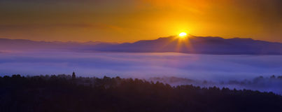 Misty dawn over wooded mountains. Galicia, Spain Royalty Free Stock Image