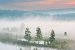 Misty dawn on the river. Heavy fog stock image
