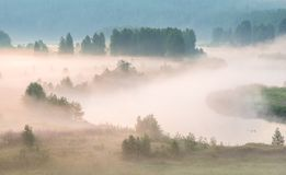 Misty dawn on the river. Heavy fog royalty free stock photography