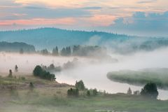 Misty dawn on the river. Heavy fog stock images