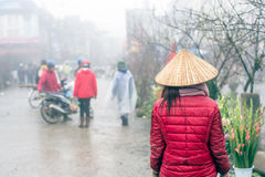 Misty day in Sapa, Vietnam. Sapa, Vietnam - February 13, 2015: Scene from a misty day at the market in Sapa. Sapa is famous for its rugged scenery and its stock photo