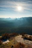 Misty daybreak in beautiful hilly landscape. Peaks of hills are sticking out from fog Royalty Free Stock Photography